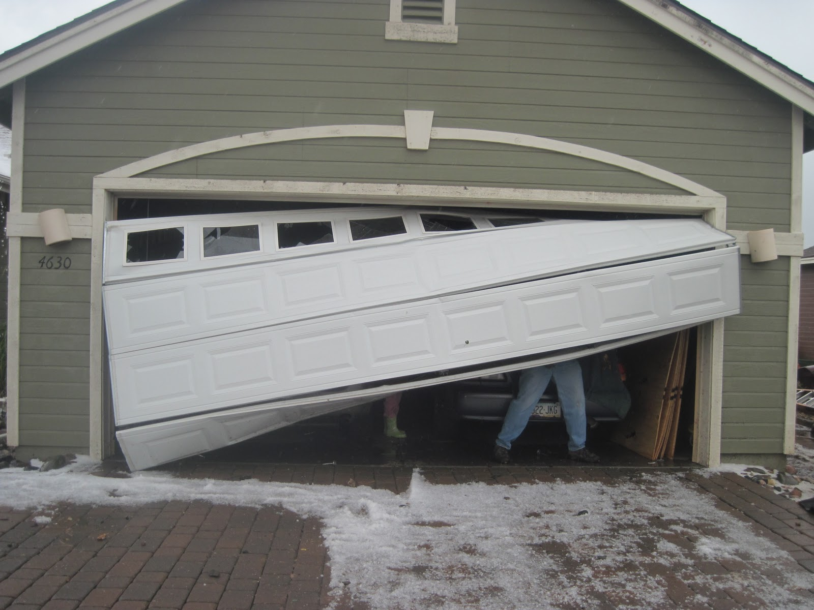 Does homeowner insurance cover garage door repair or for Garage gate repair